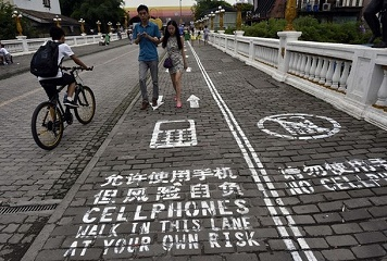 Chinese city with separate sidewalks for mobile phone addicts
